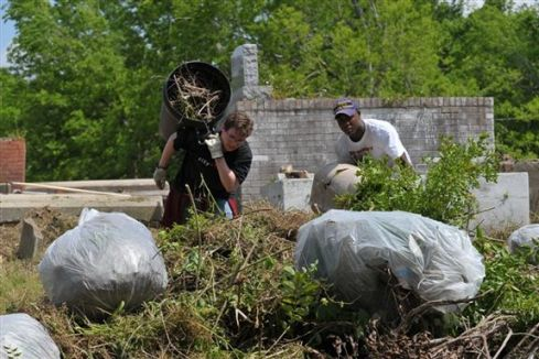 ...mowing and hauling tons of trash and debris...
