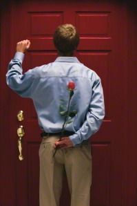 young-man-knocking-holding-rose-686406-gallery