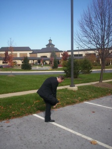 "Me pretending to ""dust off my feet"" outside a megachurch that was famous for showing ""The Godmakers."" Not one of my finest moments."