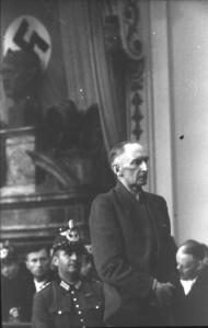 Erwin von Witzleben, one of the high ranking conspirators in the July 1944 plot to assassinate Hitler, in his own show trial before the People's Court, Aug. 7, 1944 (source: http://tinyurl.com/qxpbup5).