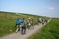 Pilgrims approaching a giant chalk cross