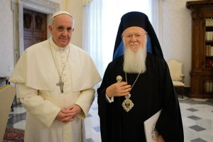 Pope Francis and Ecumenical Patriarch Bartholomew pose for a photograph in the Pope's office