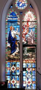 Elijah and priests of Baal. Window at St. Matthew's Lutheran, Charleston, SC. (Image: Wikipedia)