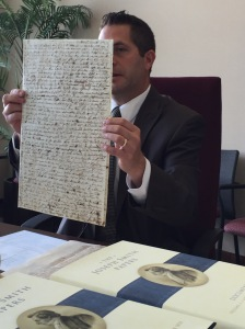Lead editor on Docs 4, Matt Godfrey shows the original foolscap sheet containing handwriting of William W. Phelps and other early Church figures.