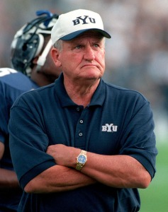 Tribune file photo BYU Coach LaVell Edwards checks the clock during a game against the Washington Huskies in 1999.